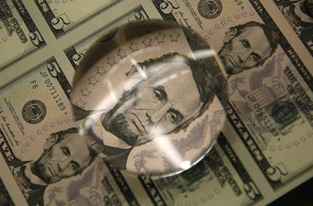 Dollar resumes descent against safe-haven currencies in volatile trade