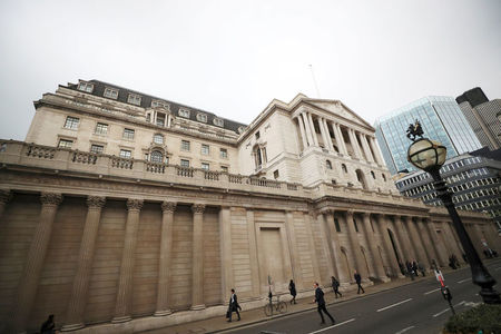 Bank of England cuts rates to 0.1%, ramps up bond-buying
